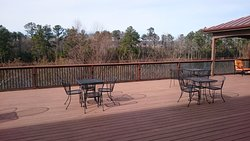 Large deck off lobby overlooking woods