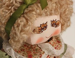 Kitty motif doll face and head.