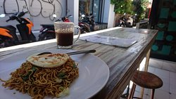 fried noodle vegetable with extra fried egg and coffee