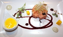 Salmon tartare with mango and red berry sauce