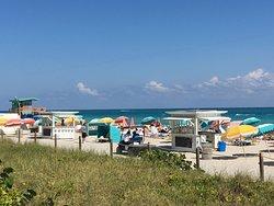 The Confidante's beach chairs and umbrellas