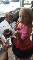 """Ms.G and her donut  (made """"small"""" just for her)."""