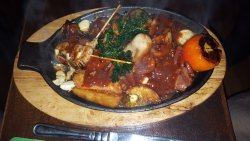 sizzling meat dish