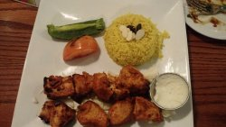 Shish Tawook - Marinated grilled Chicken with basmati rice, yummy sauce, and two grilled veggies