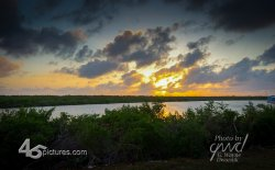 The lagoon view faces west, is sheltered from prevailing East winds and offers fine sunset viewi