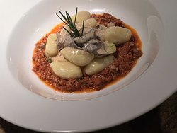 Gnocchi with lamb ragu' and porcini mushrooms