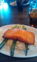 Cedar plank salmon with risotto and prosciutto wrapped asparagus.