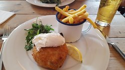 Delicious Salmon Fish Cake and Poached Egg, with Rocket and Fries