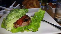 Protein Style Burger with roasted tomato and onion