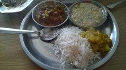 rajma , boondi raita , moolee thechua , boiled rice