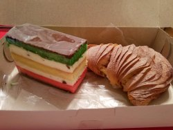 Lobster tail w/cannoli filing on right, and wedge of rainbow cannoli cake on left!