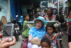with kids in Becak threewheels local traditional transport