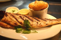 Seabass - Strong in taste, white textured fish served whole with new potatoes
