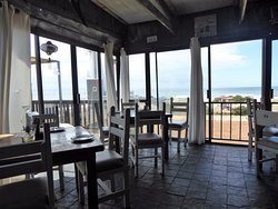 Inside restaurant looking out to beach and sea