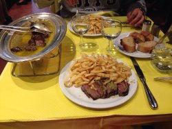 The perfect cooked meat with a mountain of happiness (or fries).