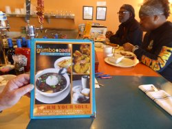 Gumbo Diner Menu with seating at the counter.