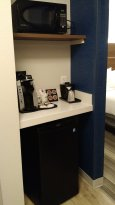 Microwave, coffee, and fridge