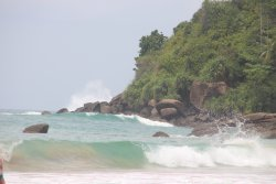 Waves crashing onto the beach below the hotel