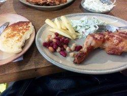 A meal at Nando's: chicken, fries, slaw, three bean salad and garlic bread