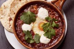 Shakshuka with tahini yoghurt and flatbread - brunch