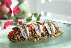 Salad with lentils ,baked red peppers and sardines carpaccio