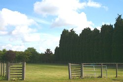 Leisure paddock for sports and games, Suffolk Glamping with fire pit, hot tub and sauna.