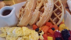 Waffles with real maple syrup, scrambled eggs and fruit.