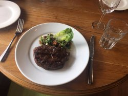 Rib fillet 350g braised peas, smoked bacon, baby onions & wilted baby cos lettuce