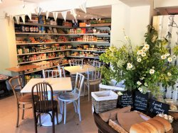 Our cosy cafe area with a selection of local produce and Hobbs House Bakery sourdough bread.