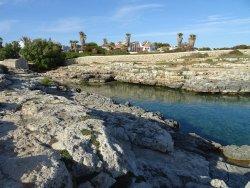 small rocky cove near ES CASTELLAR FORT-sa caleta