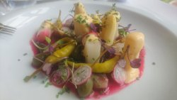 smoked sardines with white asparagus, capers, and pepper in beetroot juice