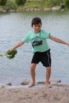 My grandson having fun by the lake.