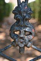 Cast iron gate surrounding plantation