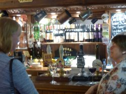 The bar area with local beers on up to 4 hand pumps on offer