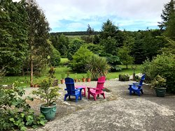 Beautiful garden amongst fragrant flowers and comfortable seating