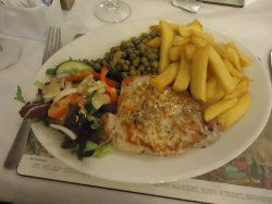 Pork chop, salad and chips at the Jolly Restaurante