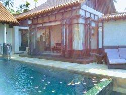 The outdoor TV/2nd bedroom in the Oceanfront Pool Villas