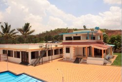 A view of the Bungalow equipped with 7AC rooms, facing the pool and a grand dining hall on the l