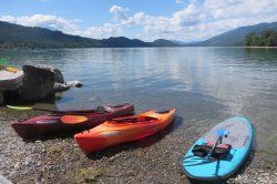 Kayaks and stand up board on Whitefish Lake