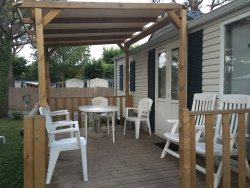 Mobile home with deck seating for 8