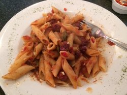 Pasta dish with Ivano sauce - Anchovy, tomato, olive and basil - before a touch of chili and gar
