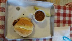 Small but GOOD pulled pork sandwich  with cup of beans or cup of mashed potatoes.