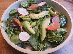 Primavera Salad with dandelion, watercress, avocado, asparagus and grapefruit vinaigrette