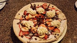 Pizza Dessert, strawberries, bananas topped with cannoli filling