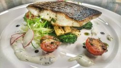 Stone Bass Fillet on a bed of Pan- Fried Tender Broccoli and Baby Corn served with Lime Wasabi S