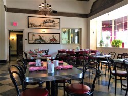 The spacious dining room off the entrance of the Pontchartrain Hotel is tastefully decorated.