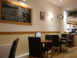 Bright, light, and simple interior, with twenty two seats in the cafe.