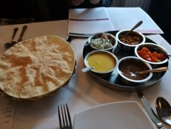 Poppadoms to start with a large variety of condiments