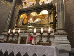 The body of St John Vianney lies incorrupt on the side altar