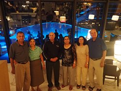 Famility Phot with beautiful background of glass decor on outdoo lobby.
